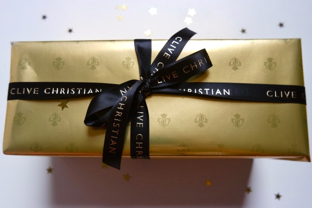 Clive Christian Candle gift set wrapped in gold paper and black ribbon